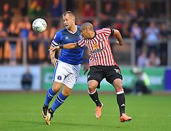 Carlisle United's Danny Grainger battles with Sunderland's Wahbi Khazri