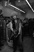 Photo of Adam Clayton - U2 visiting a Juke Box store - Atlanta  USA - December 1981