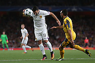 Renato Steffen of FC Basel heads the ball past Santi Cazorla of Arsenal. UEFA Champions league group A match, Arsenal v FC Basel at the Emirates Stadium in London on Wednesday 28th September 2016.<br /> pic by John Patrick Fletcher, Andrew Orchard sports photography.