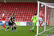 Goal 1 - 0  George Lloyd (19) of Cheltenham Town jumps as the header from Tony Craig (24) of Crawley Town goes into his own net during the EFL Sky Bet League 2 match between Cheltenham Town and Crawley Town at Jonny Rocks Stadium, Cheltenham, England on 10 October 2020.