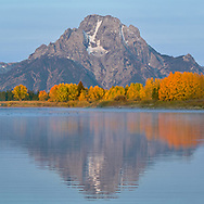 Reflections on the fall beneath Mt. Moran in Grand Teton National Park.