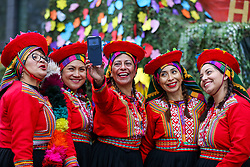 © Licensed to London News Pictures. 01/01/2020. London, UK. Performers takes a selfie during the London New Year's Day Parade in central London. Over 10,000 performers representing the London boroughs and countries from across the globe are parading from Piccadilly Circus to Parliament Square as tens of thousands of Londoners and tourists line the route. Every year, dancers, acrobats, cheerleaders, marching bands, historic vehicles and more assemble in the heart of the capital for a colourful celebration of contemporary performances and traditional pomp and ceremony. Photo credit: Dinendra Haria/LNP