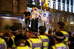 © Licensed to London News Pictures. 19/09/2014. Glasgow, UK. Police officers separate Scottish independence supporters and pro-unionists at George Square in Glasgow as Scotland decides to stay in the union and First Minister Alex Salmond resigns over the results of the Scottish independence referendum on Friday, 19 September 2014. Photo credit : Tolga Akmen/LNP