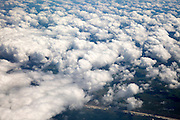 Looking down from a plane at cumulus clouds over western Denmark