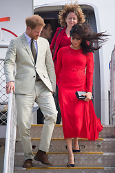 The Duchess of Sussex's hair blows in the wind as she arrives with the Duke of Sussex at Fua'amotu Airport, Tonga, on day one of the royal couple's visit to Tonga.