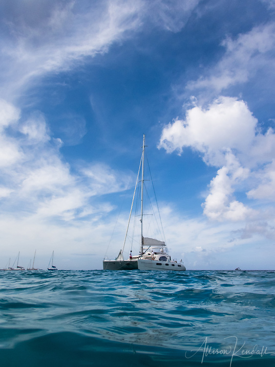 Water-level view of a luxury catamaran, anchored off the coast of Barbados in the Caribbean Sea