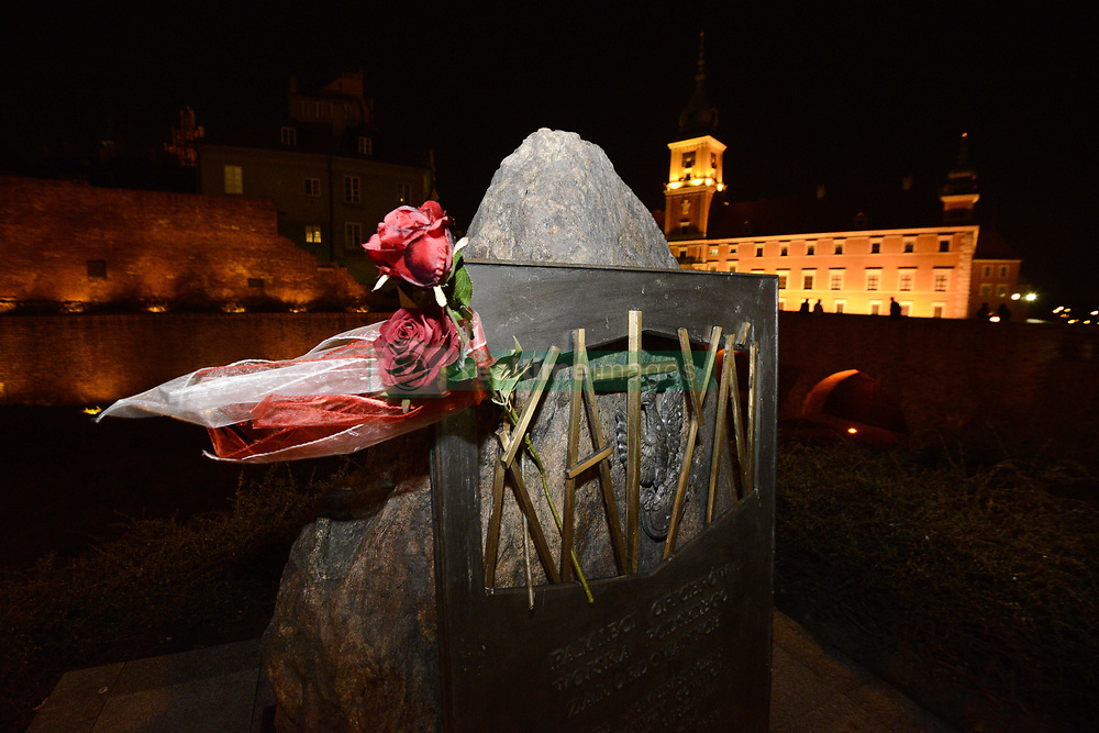 April 12, 2018 - Warsaw, Poland - The monument built for the victims of the Katyn massacre in Russia in which some 20 thousand Polish officers and Polish intelligentsia where murdere in 1940 by Soviet secret police is seen in Warsaw, Poland on April 12, 2018. On Friday Polish president Andrzej Duda will lay a wreath to commemorate the victims whose mass graves have been found by German forces on April 13, 1942. (Credit Image: © Jaap Arriens/NurPhoto via ZUMA Press)