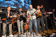 From left to right, Oscar Brand, Josh White, Jr., Pete Seeger, and Tom Chapin at the Folk City benefit concert at the Museum of the City of New York. The concert was held to support a forthcoming exhibit on the folk msusic revival in New York in the 1950s and 60s.