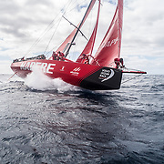 Leg 02, Lisbon to Cape Town, day 19, on board MAPFRE, Antonio Cuervas-Mons at the bow during a pilling, Sophie Ciszek holding the sail behind him. Photo by Ugo Fonolla/Volvo Ocean Race. 23 November, 2017.
