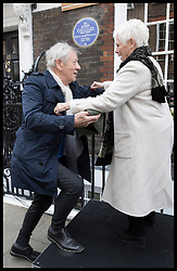 April 27, 2017 - London, London, United Kingdom - Image licensed to i-Images Picture Agency. 27/04/2017. London, United Kingdom. Dame Judi Dench helps Sir Ian McKellen up onto a podium after the unveiling of an English Heritage blue plaque to Sir John Gielgud at his former home in Cowley Street, London, where he lived for 31 years. Picture by Stephen Lock / i-Images (Credit Image: © Stephen Lock/i-Images via ZUMA Press)