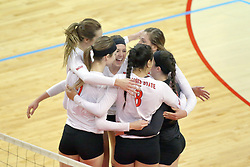 17 October 2014:  Redbirds celebrate a point during an NCAA Missouri Valley Conference (MVC) womens volleyball match between the Northern Iowa Panthers and the Illinois State Redbirds for 1st place in the conference at Redbird Arena in Normal IL
