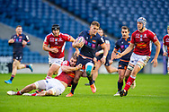 Duhan van der Merwe (#11) of Edinburgh Rugby tries to break free of the tackle of Romain Briatte (#6) of SU Agen Rugby during the European Rugby Challenge Cup match between Edinburgh Rugby and SU Agen at BT Murrayfield, Edinburgh, Scotland on 18 January 2020.