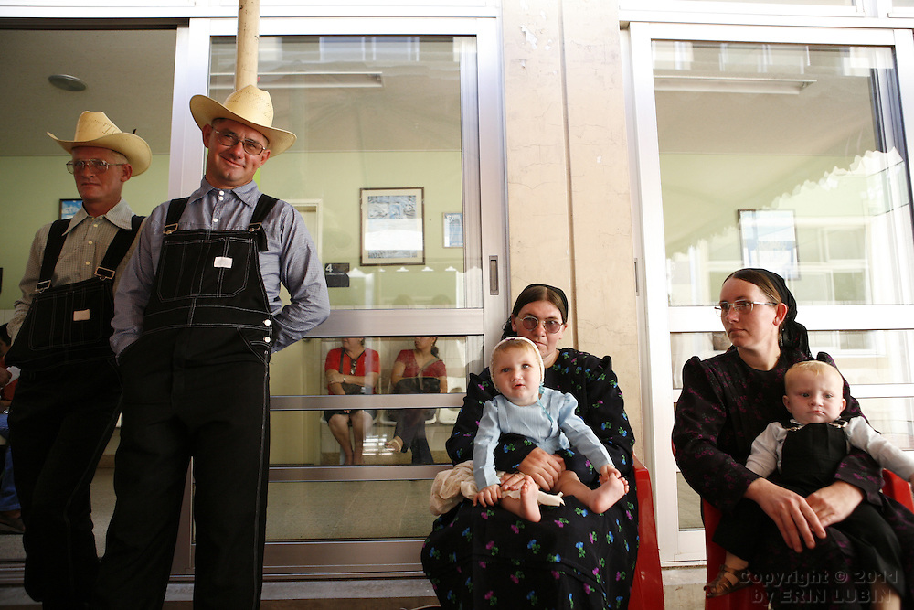 Mennonite families, from left, Peter Fehr, Isaac Neustaeter, Anna Neufeld, holding daughter Maria Neustaeter, 11 months old, Katharina Friesen, holding Peter Fehr, one year old, wait for their children's turns during the screening process at the Hospital Japones in Santa Cruz, Bolivia on Thursday, November 8, 2007, during Operation Smile's World Journey of Smiles...Photograph by Erin Lubin