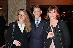Left to right, ALEXANDRA SCOTT, SIMON RALPH and CHRISTABEL ABDY COLLINS at a party in honour of the Walking With The Wounded team members held at Bodo's Schloss, 2A Kensington High Street, London on 13th November 2013.