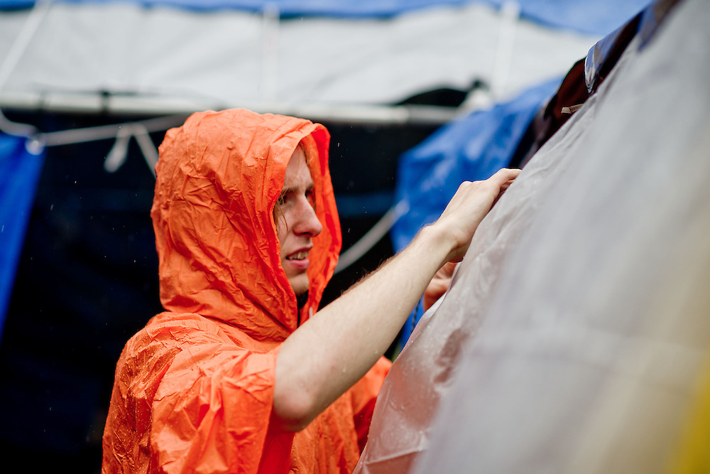 Josh Turner of Newark, Del. secures a tent to keep the rain out at the Occupy Delaware encampment on Wednesday, Nov. 16, 2011 in Wilmington, Del. (Photo by Jay Westcott/Politico)