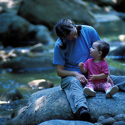 A mother and daughter play in Lucy Brook in New Hampshire's White Mountains.  Recently protected by TPL.  Bartlett, NH