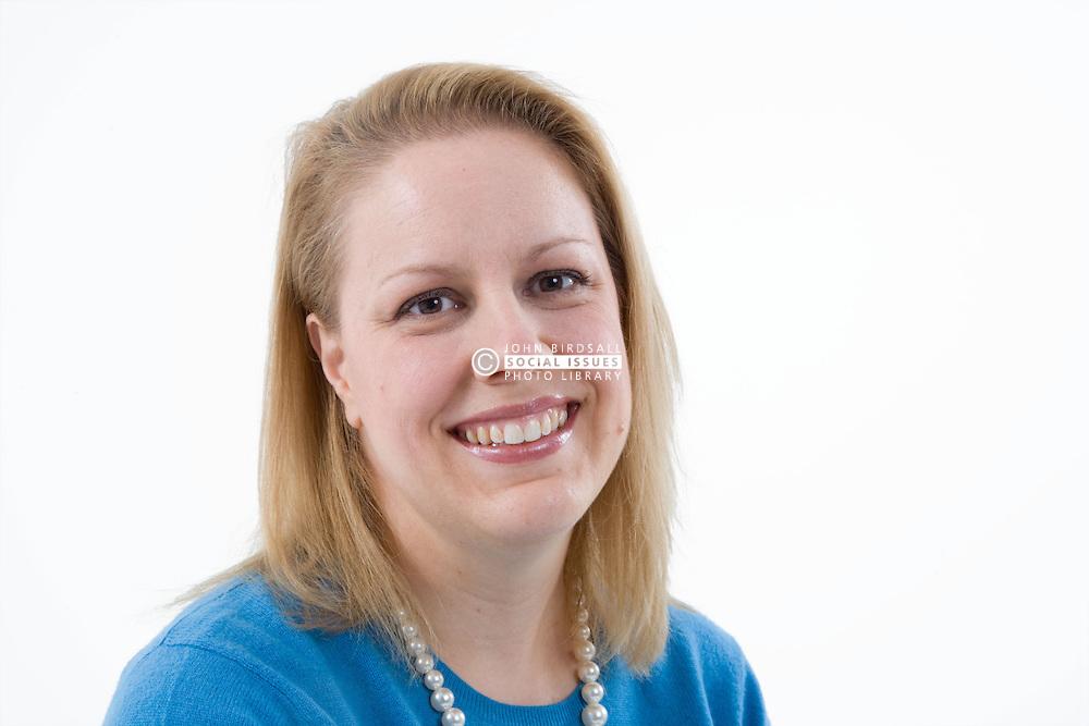 Studio portrait of a woman smiling,