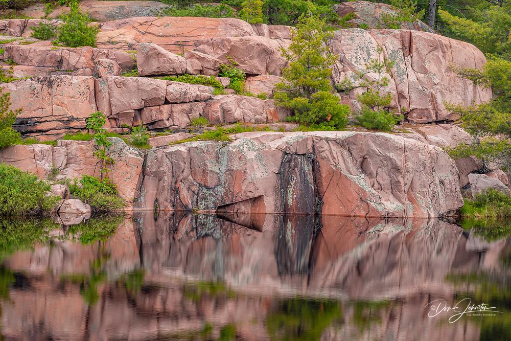 Reflections in Cranberry Bog beaver pond, Killarney Provincial Park, Killarney,, Ontario, Canada