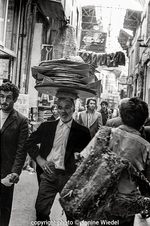 Traders carrying heavy loads in Grand Bazaar in Tehran  Iran 1970s