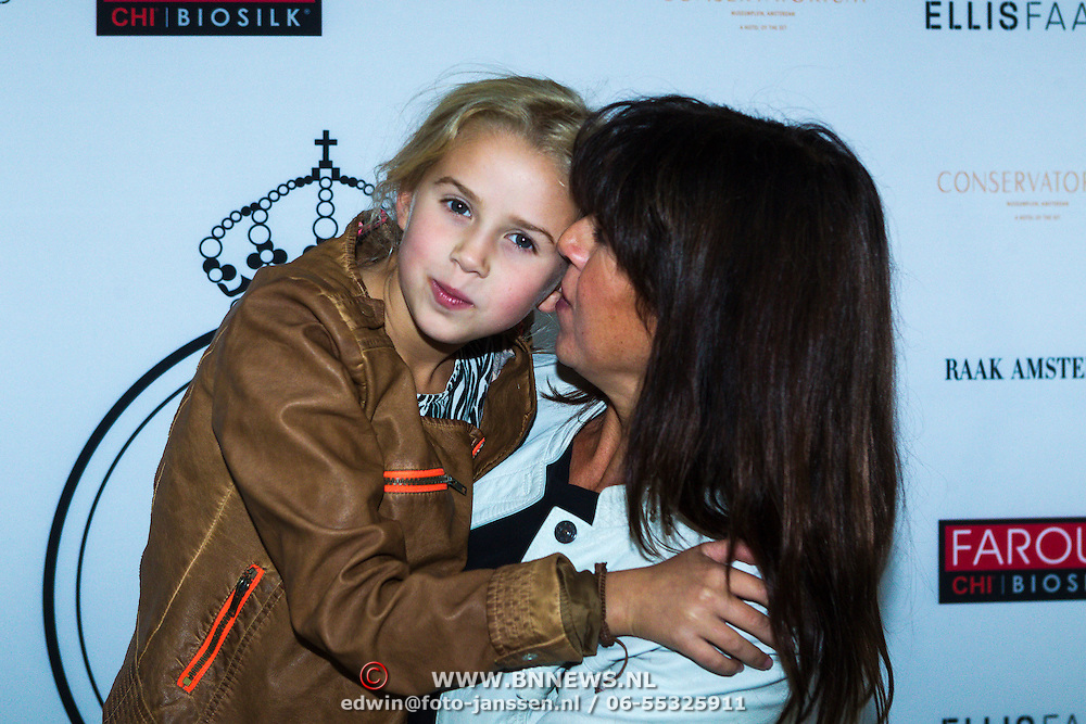 NLD/Amsterdam/20130916 -  Modeshow Jos Raak in het Conservatorium hotel, Isa Hoes en dochter Vlinder