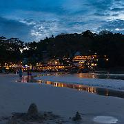 Beautiful sunset scene at Kata beach with small restaurants and surf line, Phuket, Thailand