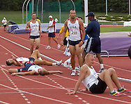 US and German decathletes collapse at the finish line of the 1,500-meter run, at the Nike Combined Events Challenge at the R.V. Christian Track Complex on the campus of Kansas State University in Manhattan, Kansas, August 6, 2006.