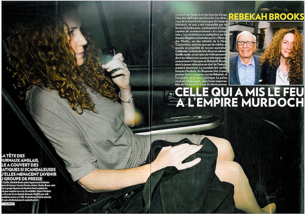 Paris Match Centre spread of Rebekah Brooks leaving Rupert Murdoch's central London home July 2011.