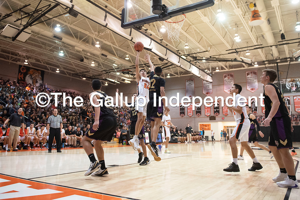 Gallup Bengal Quinn Atazhoon (24) takes a shot inside the paint in Friday night's district 1-4A tournament championship game against Kirtland Central Broncos at Gallup High School in Gallup. The Bengals beat the Broncos 60-41.