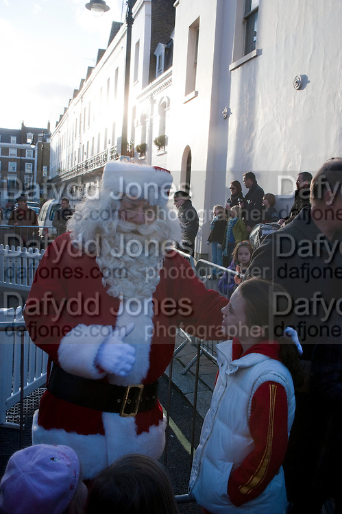 FATHER XMAS, Belgravia Christmas Sunday. Elizabeth Street, Motcomb Street and Pimlico Rd. various Christmas activities. Father Christmas will also visited each street on his sleigh pulled by his reindeer. London. 6 December 2009<br />  <br />  *** Local Caption *** -DO NOT ARCHIVE-© Copyright Photograph by Dafydd Jones. 248 Clapham Rd. London SW9 0PZ. Tel 0207 820 0771. www.dafjones.com.<br /> FATHER XMAS, Belgravia Christmas Sunday. Elizabeth Street, Motcomb Street and Pimlico Rd. various Christmas activities. Father Christmas will also visited each street on his sleigh pulled by his reindeer. London. 6 December 2009