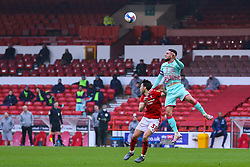 Matt Grimes of Swansea City climbs above Harry Arter of Nottingham Forest  - Mandatory by-line: Nick Browning/JMP - 29/11/2020 - FOOTBALL - The City Ground - Nottingham, England - Nottingham Forest v Swansea City - Sky Bet Championship