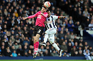 Peterborough's Michael Smith (l) beats West Brom's Stephane Sessegnon to a header. The Emirates FA Cup, 4th round match, West Bromwich Albion v Peterborough Utd at the Hawthorns stadium in West Bromwich, Midlands on Saturday 30th January 2016. pic by Carl Robertson, Andrew Orchard sports photography.