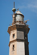 Port Said, Egypt - April 24, 2010: The Port Said lighthouse was completed in 1869, one week prior to the inauguration of the Suez Canal. It was one of the early structures to be made with reinforced concrete.
