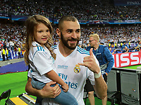 KIEV, UKRAINE - MAY 26: Karim Benzema of Real Madrid with his daughter celebrate winning the UEFA Champions League final between Real Madrid and Liverpool at NSC Olimpiyskiy Stadium on May 26, 2018 in Kiev, Ukraine. (MB Media)