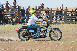 Jay Allen rides his hopped up Harley-Davidson FXR in the Spur Creek Ranch rodeo arena on highway 79 north of Sturgis on the Michael Lichter - Sugar Bear ride during the annual Sturgis Black Hills Motorcycle Rally. SD, USA. August 3, 2014.  Photography ©2014 Michael Lichter.