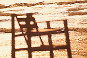 USA - Newport, RI - Lifeguard chair in glare of sun off waves, first beach, easton's beach (selective focus).