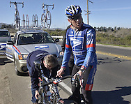 Lance Armstrong stops for a moment to get a new rear wheel for his bike from the USPS Pro Cycling chief mechanic Julien de Vriese  during a training session Friday, January 23, 2004 near the town of Solvang, CA.  The team, led by five-time Tour de France winner, Lance Armstrong is preparing for the upcoming European racing season and Armstrong's attempt to be the only six-time winner of the Tour de France.