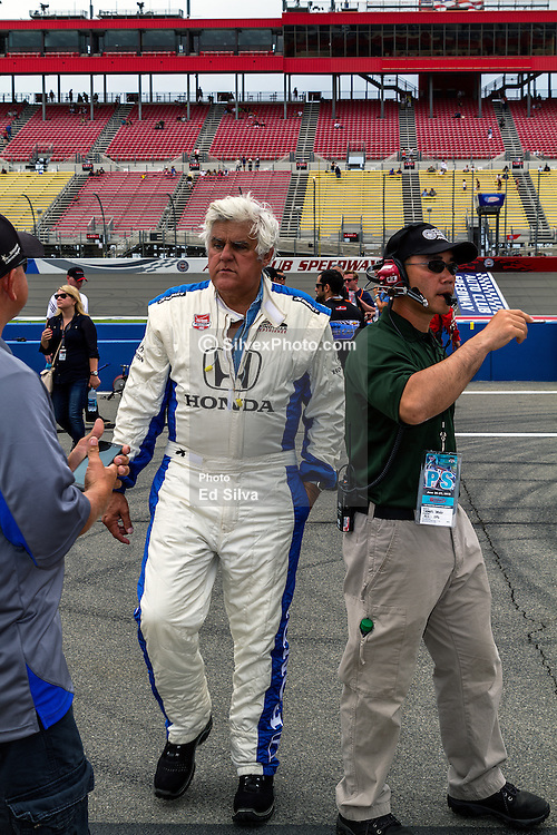 """FONTANA, CA - JUNE 27  Jay Leno host of """"Jay Leno's Garage"""" and former host of NBC's """"The Tonight Show attends the 2015 Verizon IndyCar MAVTV 500 as a guest of racing legend Mario Andretti of Andretti Autosport. Jay took a two lap ride in a two seater indycar with andretti as part of the pre-race activies. 2015 June 27. 2015 June 26. Byline, credit, TV usage, web usage or linkback must read SILVEXPHOTO.COM. Failure to byline correctly will incur double the agreed fee. Tel: +1 714 504 6870."""