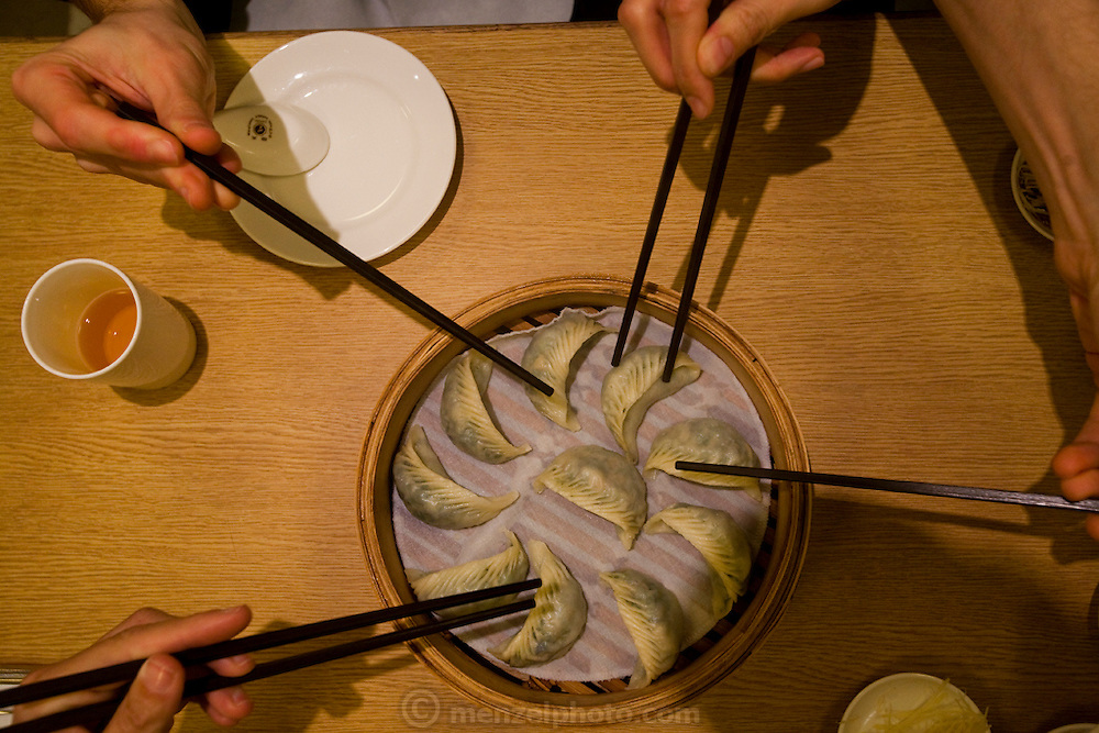 Dumplings in a steaming bamboo basket at a dumpling restaurant in Taipei, Taiwan.