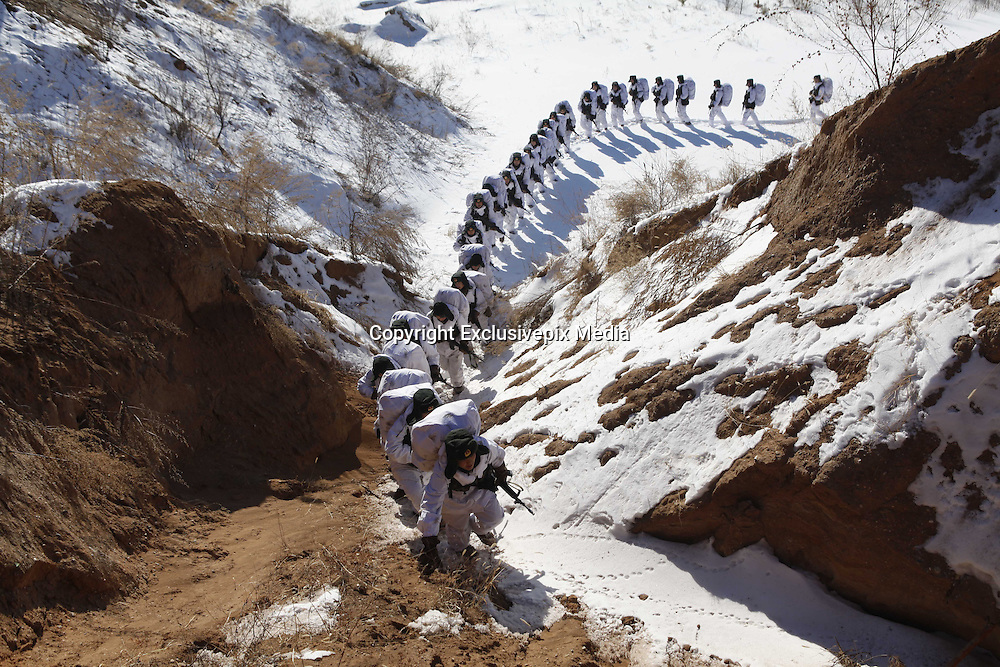 HEIHE, CHINA - JANUARY 28: (CHINA OUT) <br /> <br /> Frontier Soldiers Attend Long-distance Endurance Training<br /> <br /> Frontier soldiers attend a long-distance endurance training under the temperature of minus 26 degree celsius on January 28, 2015 in Heihe, Heilongjiang province of China. The purpose of this long-distance endurance training is to improve the frontier soldier's ability of completing task under extreme weather condition.<br /> ©Exclusivepix Media