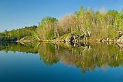 Reflection in Simon Lake. Simon Lake Park Conservation Area. <br /> Naughton<br /> Ontario<br /> Canada