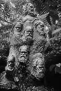 William Rickets Sanctuary - Black and white photo art print of Sculpture of  Aboriginal men people in the deep woodland of the Dandenon Mountain near Melbourne Australia. Taken 1993 by Paul Williams,