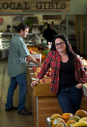 Corinne Kinczel, right, who will take over as the owner of Rocky's Market in the Oakmore neighborhood of Oakland, Calif., poses for a photograph in the grocery store, Thursday, April 7, 2016. Her partner, Brady Bellis, is at left. (D. Ross Cameron/Bay Area News Group)