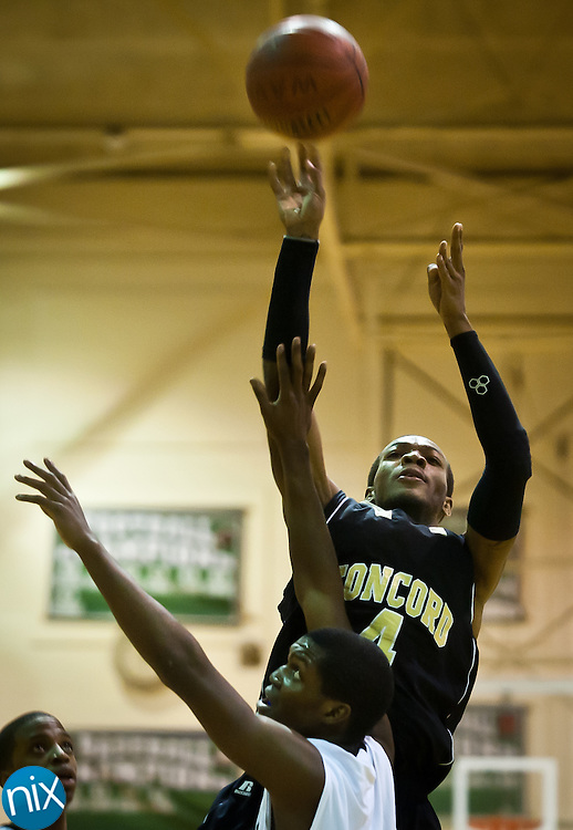Concord's Jacquise Moore takes a shot against Kannapolis Saturday night at A.L .Brown High School. Concord won the cross-town rivalry 80-73. (Photo by James Nix)