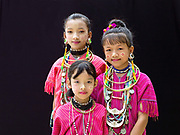 Ethnic Kayaw girls at Baan Tong Luang, Eco-Agricultural Hill Tribes Village on 7th June 2016 in Chiang Mai province, Thailand. The fabricated village is home to 8 different hill tribes who make a living from selling their handicrafts and having their photos taken by tourists