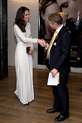 The Duchess of Cambridge, Patron of Action on Addiction, greets their Chief Executive Graham Beech, as she arrives at Working Titles Office in London to view highlights of the Recovery Street Film Festival.