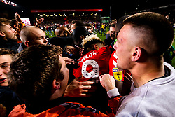 Lyle Taylor of Charlton Athletic is mobbed by fans as Charlton Athletic celebrate after beating Doncaster Rovers on penalties in the Sky Bet League One Playoff Semi Final - Mandatory by-line: Robbie Stephenson/JMP - 17/05/2019 - FOOTBALL - The Valley - Charlton, London, England - Charlton Athletic v Doncaster Rovers - Sky Bet League One Play-off Semi-Final 2nd Leg