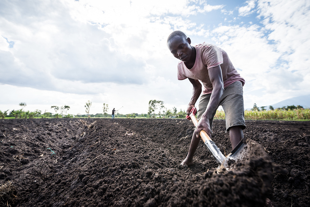 7 March 2018, Arusha, Tanzania: Hussein prepares the field to grow onions, in Usa River. The Usa River 2 project is supported by the Meru Diocese of the Evangelical Lutheran Church in Tanzania's Sustainable Livelihood programme, designed to support sustainable agriculture through biogas production and diverse practices, so as to keep the soil in good shape through many decades of work on the land.