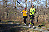 Goshen, New York - Two women run along the Heritage Trail while competing inthe Hambletonian Marathon fun run on Nov. 4, 2012. The run was put together for runners who had trained for the New York City Marathon, which was cancelled because of Hurricane Sandy.