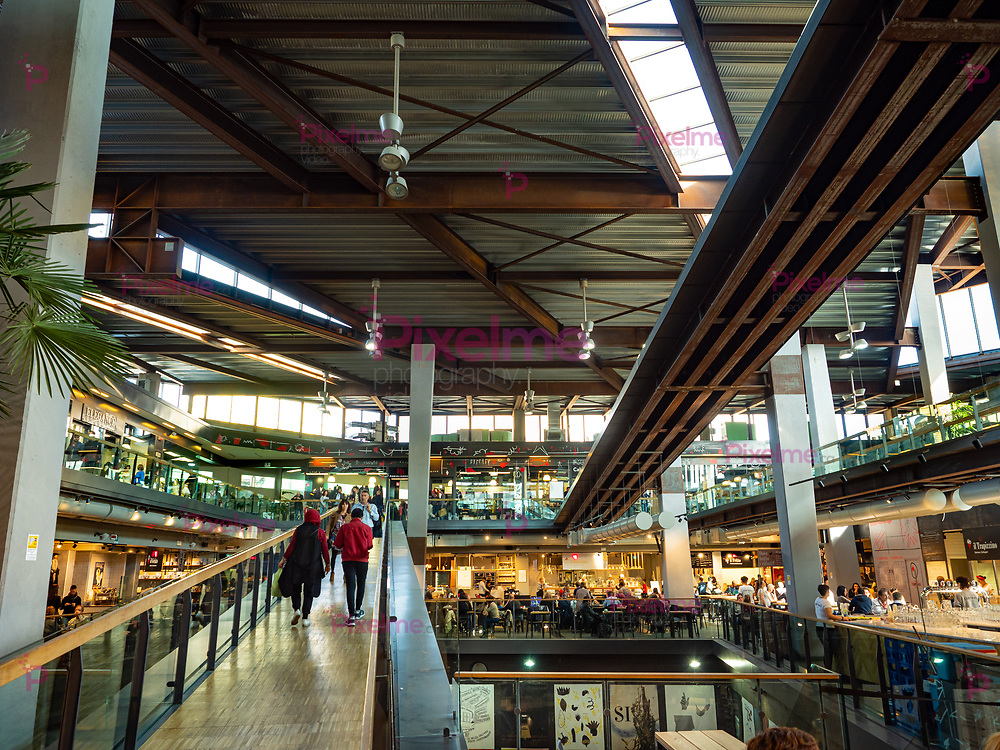 Modern interior of the new central market of Turin with shops and restaurants
