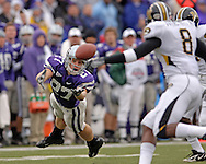 Kansas State wide receiver Jordy Nelson (L) dives for a pass in the first quarter against Missouri at Bill Snyder Family Stadium in Manhattan, Kansas, November 19, 2005.  K-State defeated the Missouri Tigers 36-28.